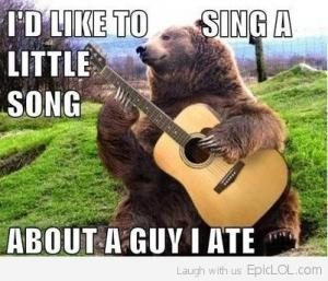 caption contest example showing bear with guitar captioned I'd like to sing a little song about a guy I ate