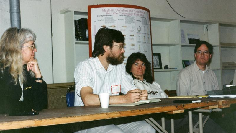 (From left) Marsha Wickle, Dan Inhoff, an unknown woman, and Mike Steinmaus at a meeting