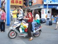 Man and woman on motor bike.