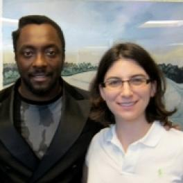Dr. Anne Henochowitz (front) with will.i.am of the music group Black-Eyed Peas (back).