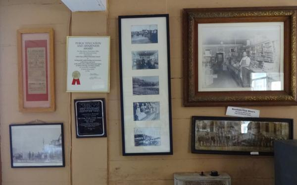Photos and awards on the wall of the Little Cities of Black Diamonds office in Shawnee, Ohio