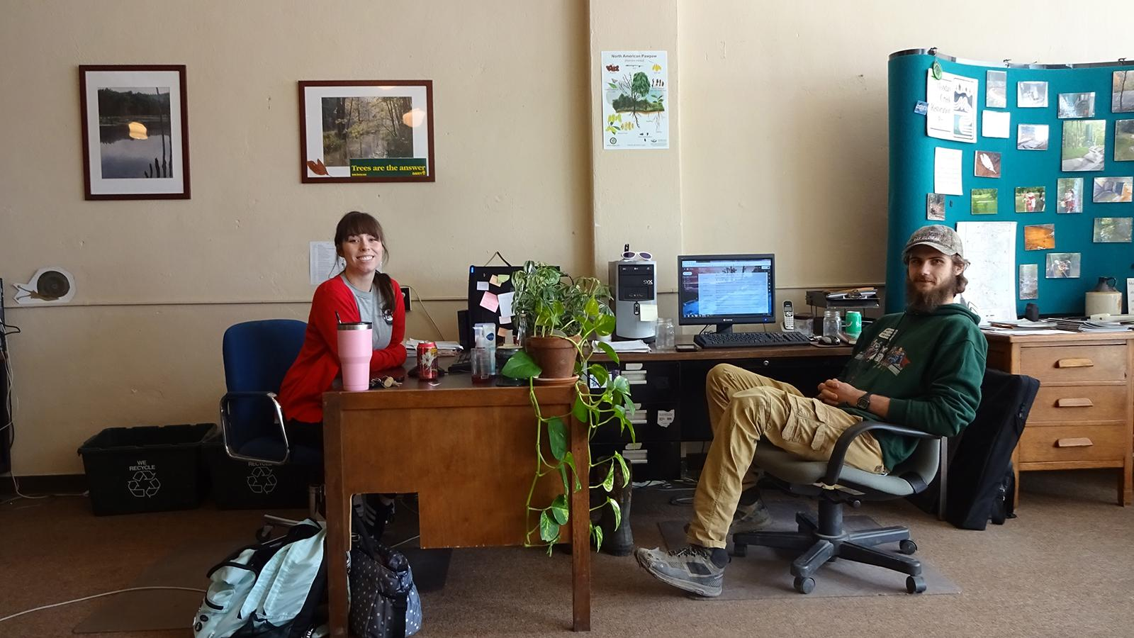 MCRP's current Americorps members: Kylee (left) and Ricky (right) in MCRP's office