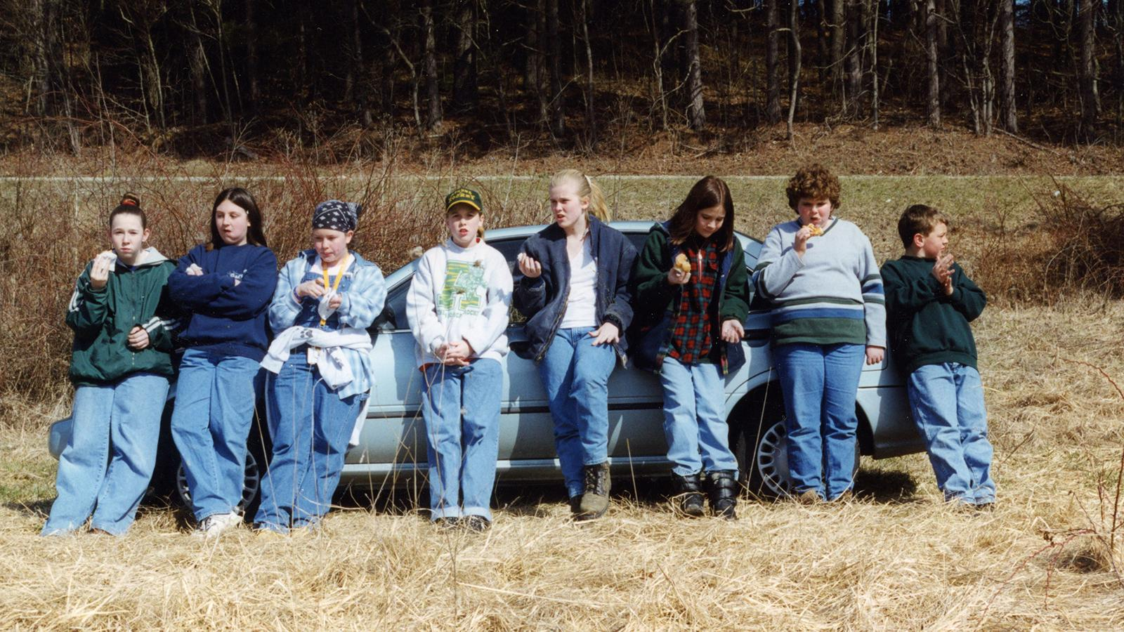 Volunteer tree-planters taking a break, North of Carbon Hill in Hocking County