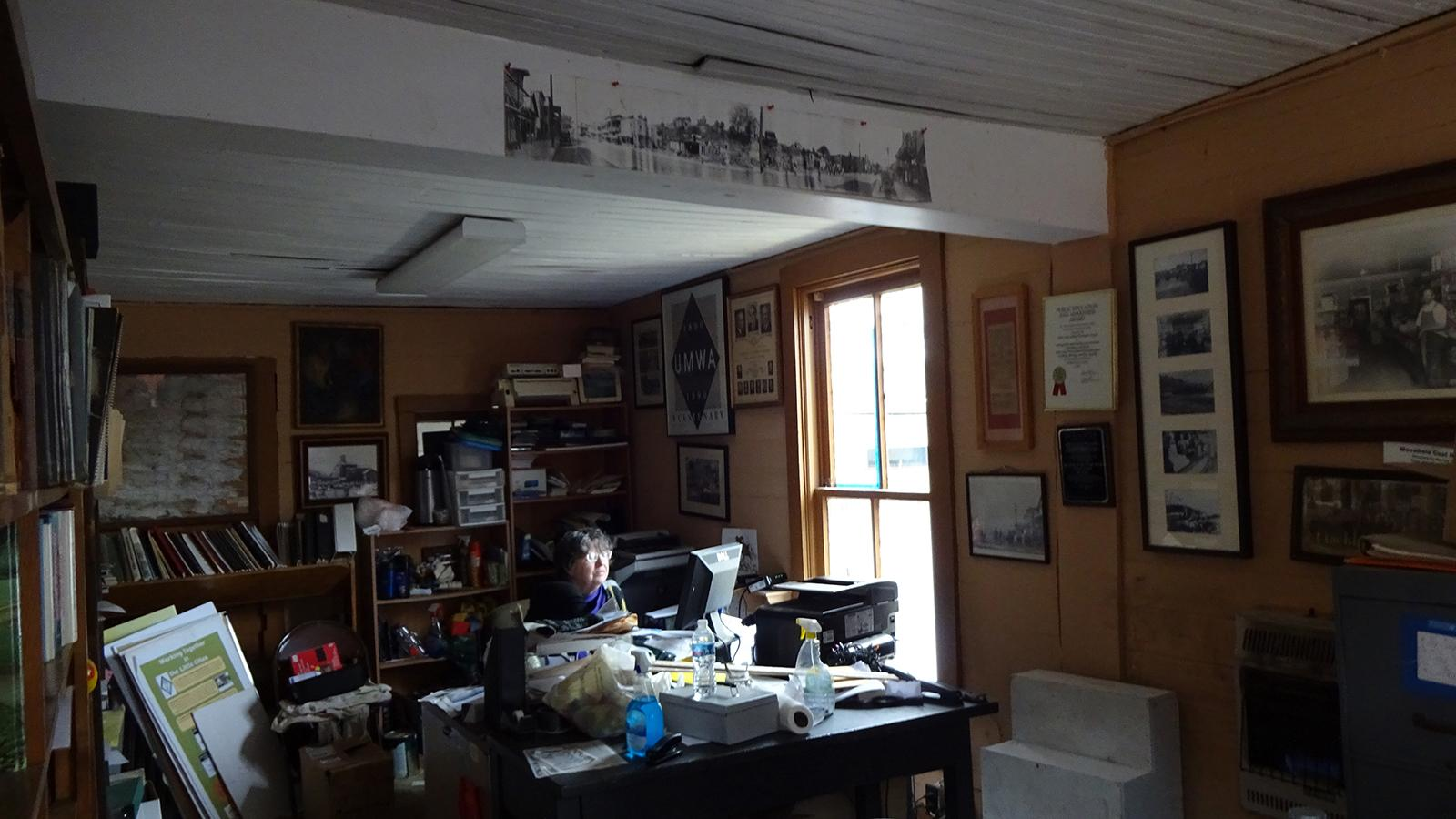 Cheryl Blosser pictured at her desk in the Little Cities of Black Diamonds Council Office