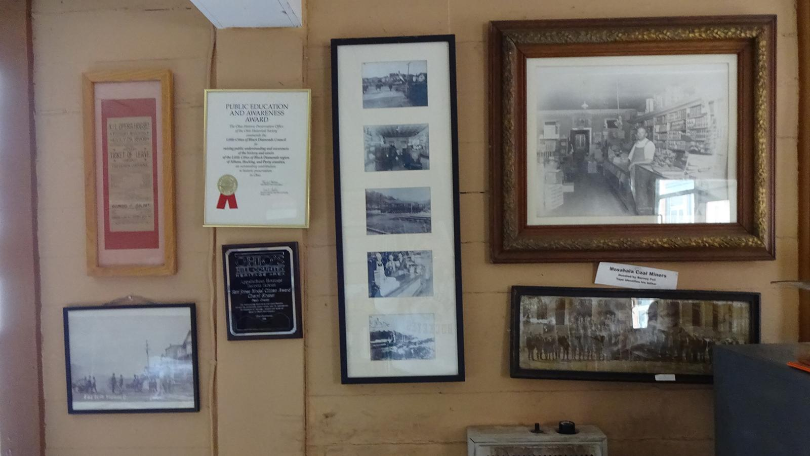 Photos and awards displayed on the wall of the Little Cities of Black Diamonds Council Office