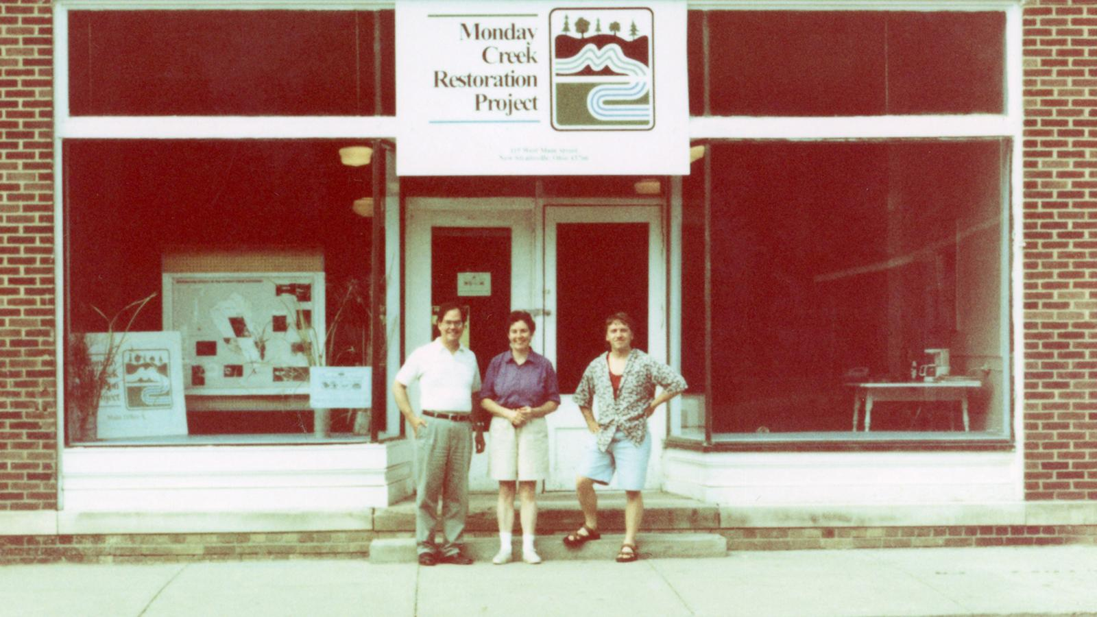 MCRP's office opening. Pictured, from left: Mike Steinmaus, Norah Newberg, and Troy Mellott (an Americorps VISTA)