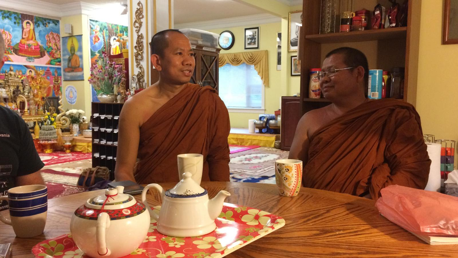 After the chanting and meditating session the house monks, Ajanh Sun Palee and Ajanh Thong Dee, have an opportunity to practice their English conversation skills over tea with guests.