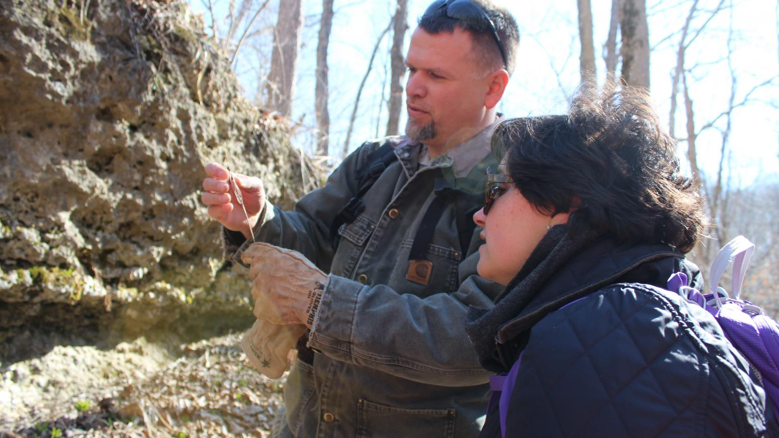 Josh Deemer chats with Cassie Patterson during a hike at Miller Sanctuary State Nature Preserve.