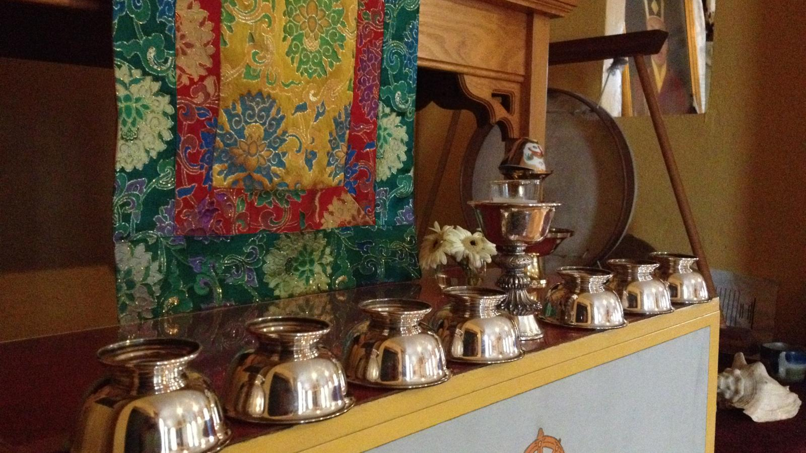 Silver bowls used for offerings at the Columbus Karma Thegsum Chöling Center