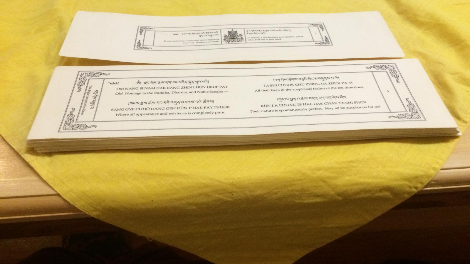 Cards with the chants and prayers transcribed at the Columbus Karma Thegsum Chöling Center