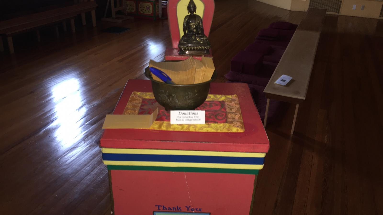 Donation box for the Karma Thegsum Choling Meditation Center