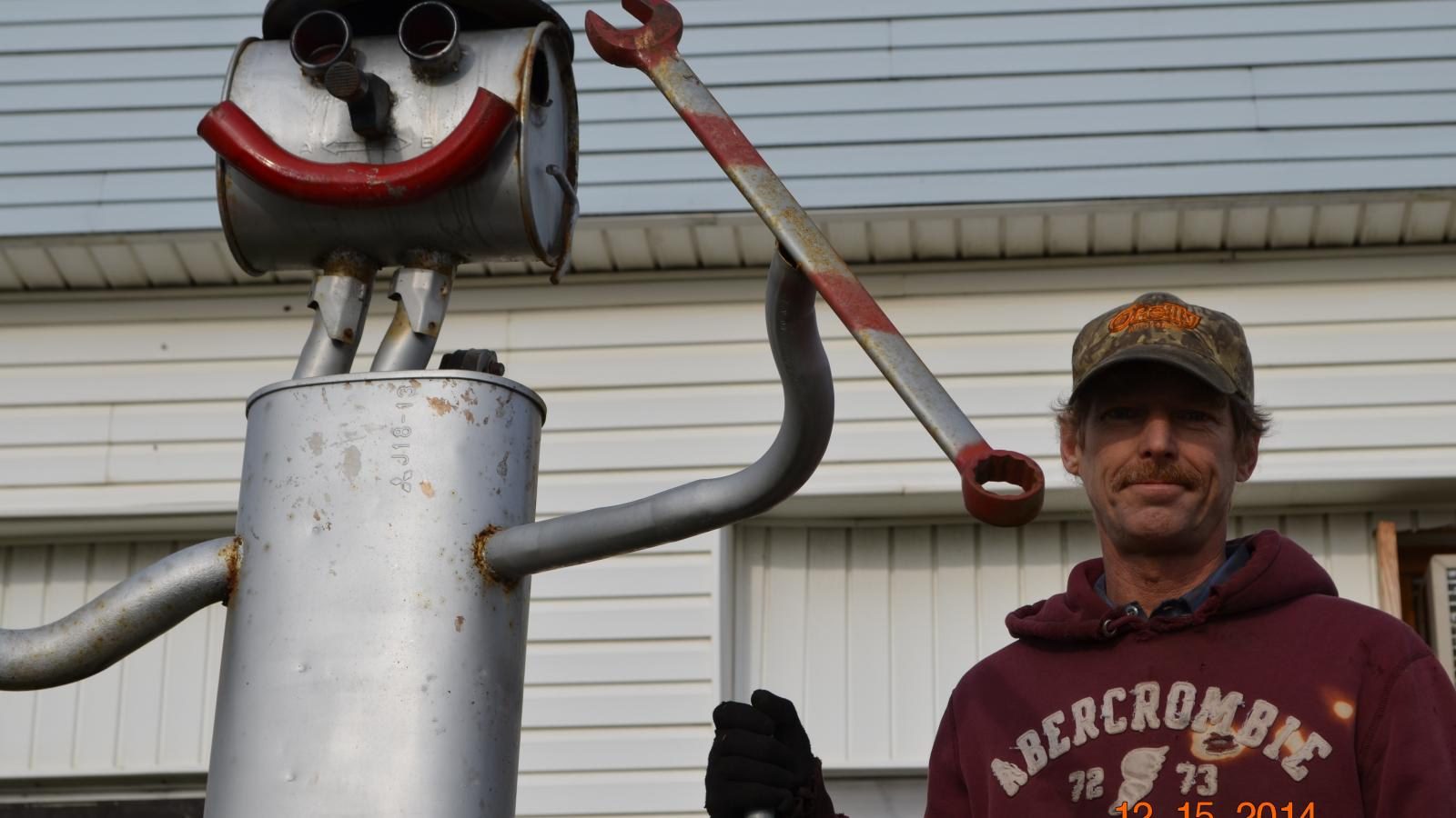 Lonnie w/ Muffler Man, Muffler Shop & Welding/Tire Station, New Rome, OH