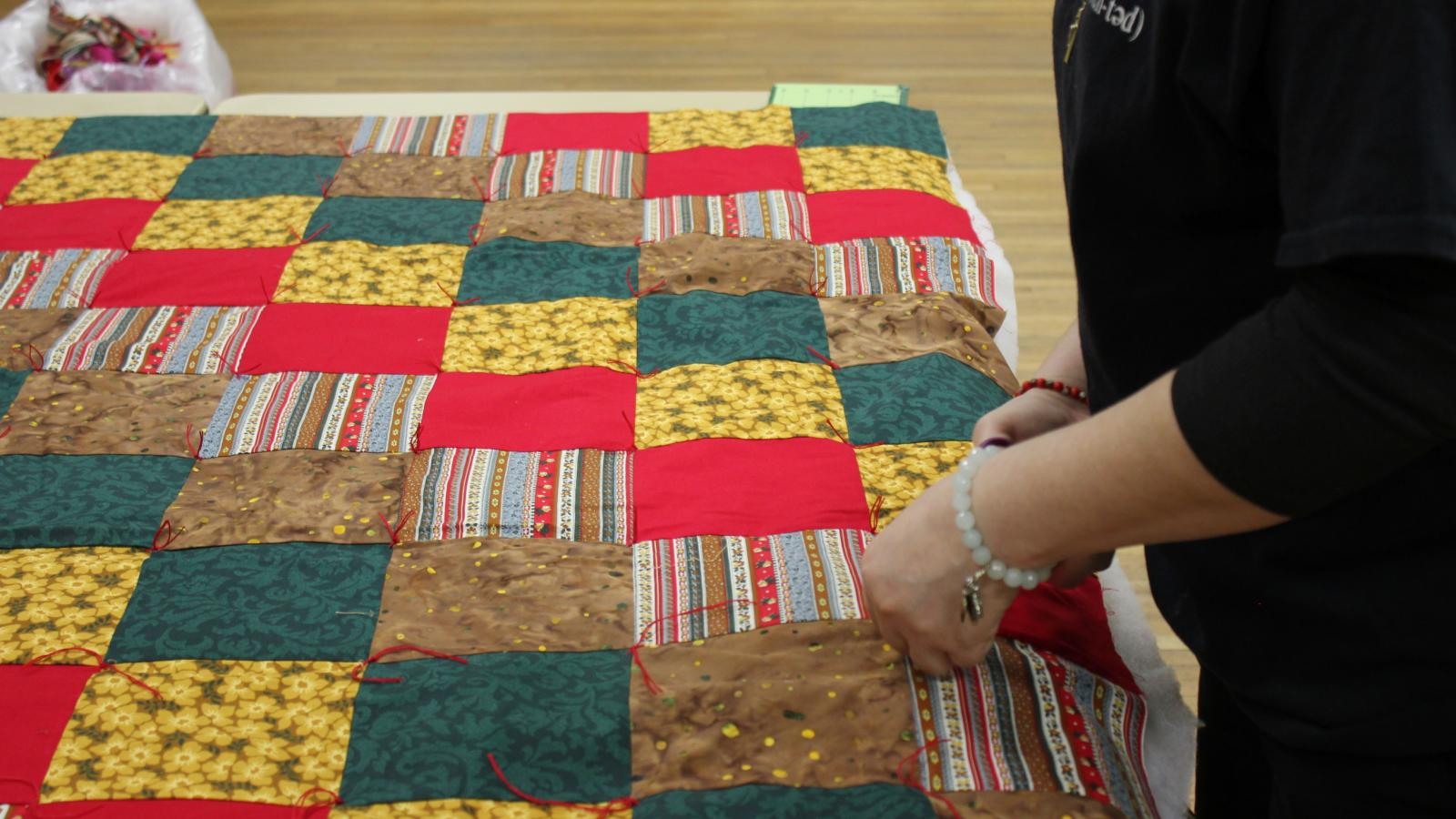 Espinal helps church women with quilts