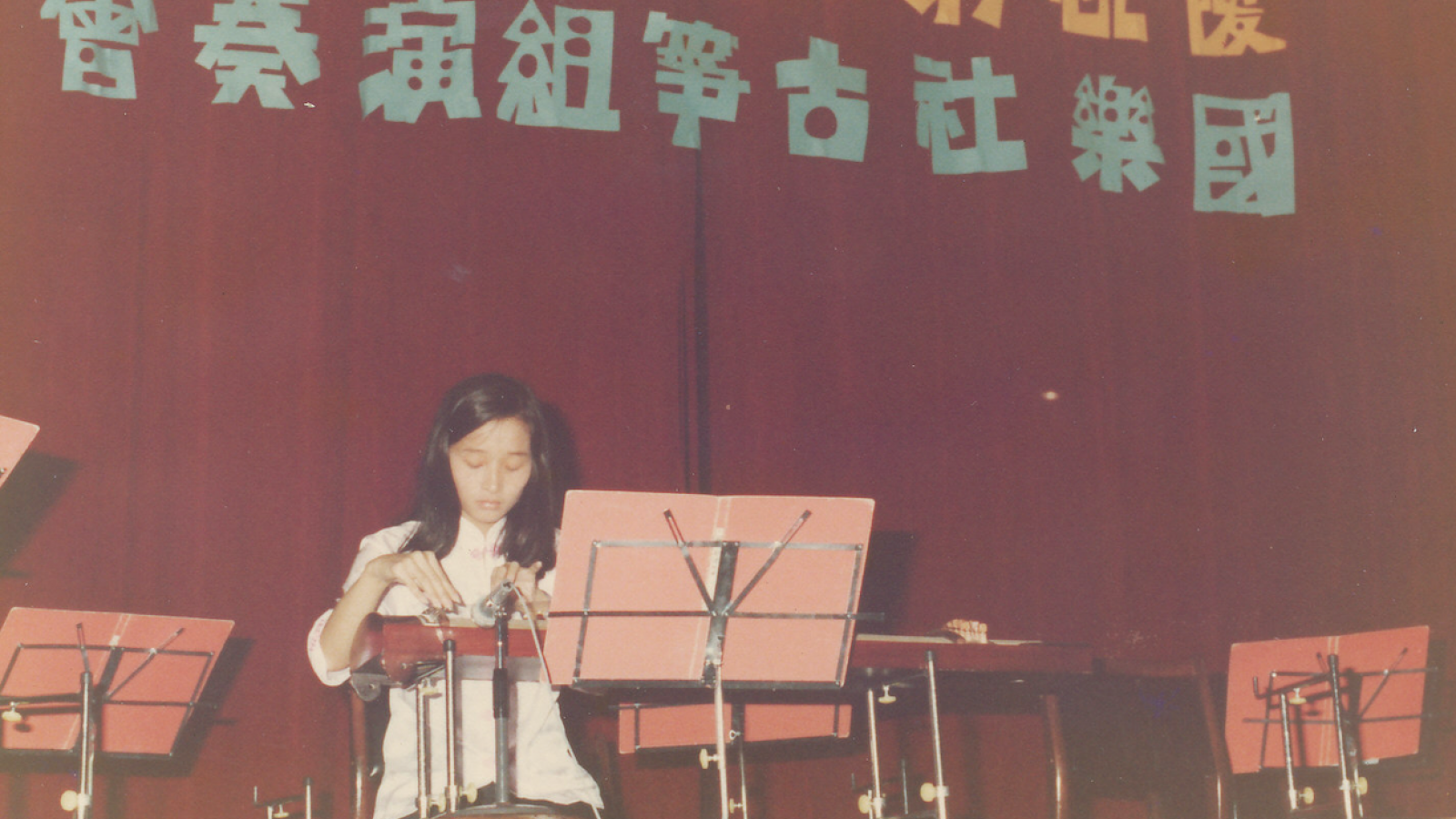 Young Lee playing guzheng at Taiwanese event