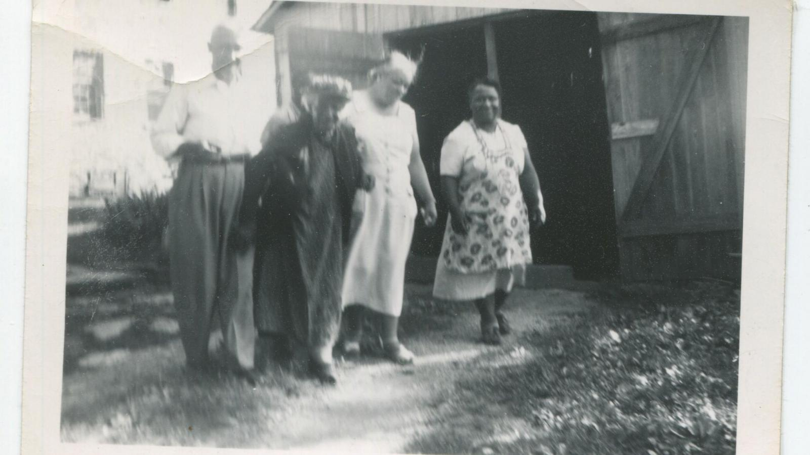 Group photo of John Luther Lewis, Anna Baker, Louise, and unknown