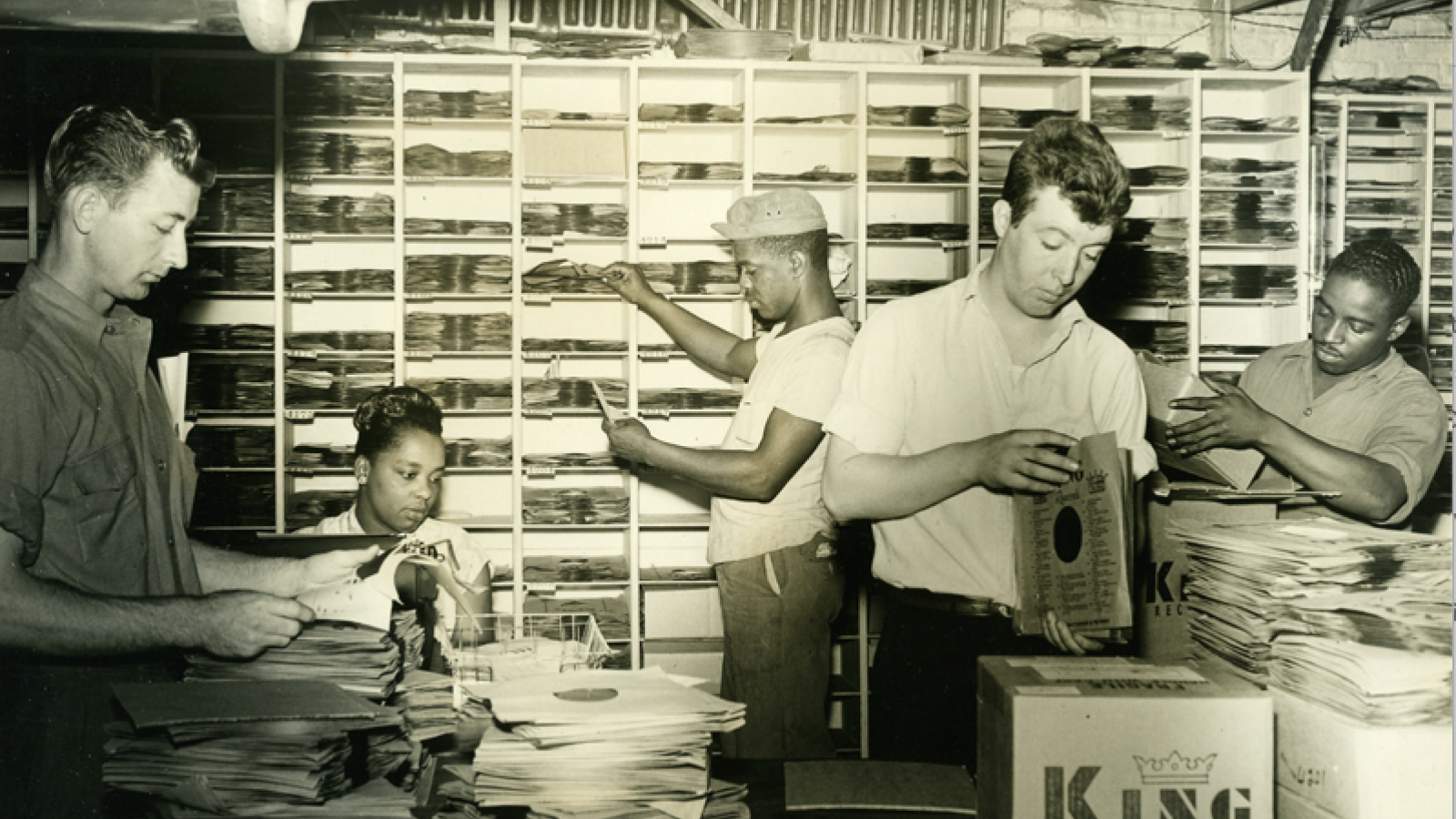 Five King Records employees sorting records