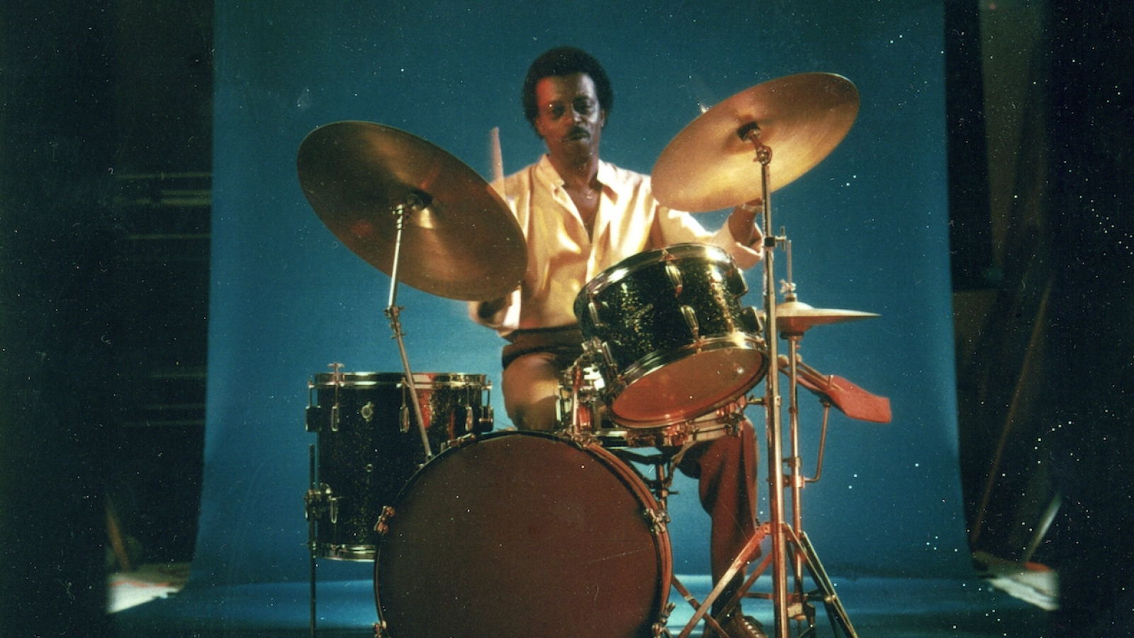 Young Philip Paul at drum set