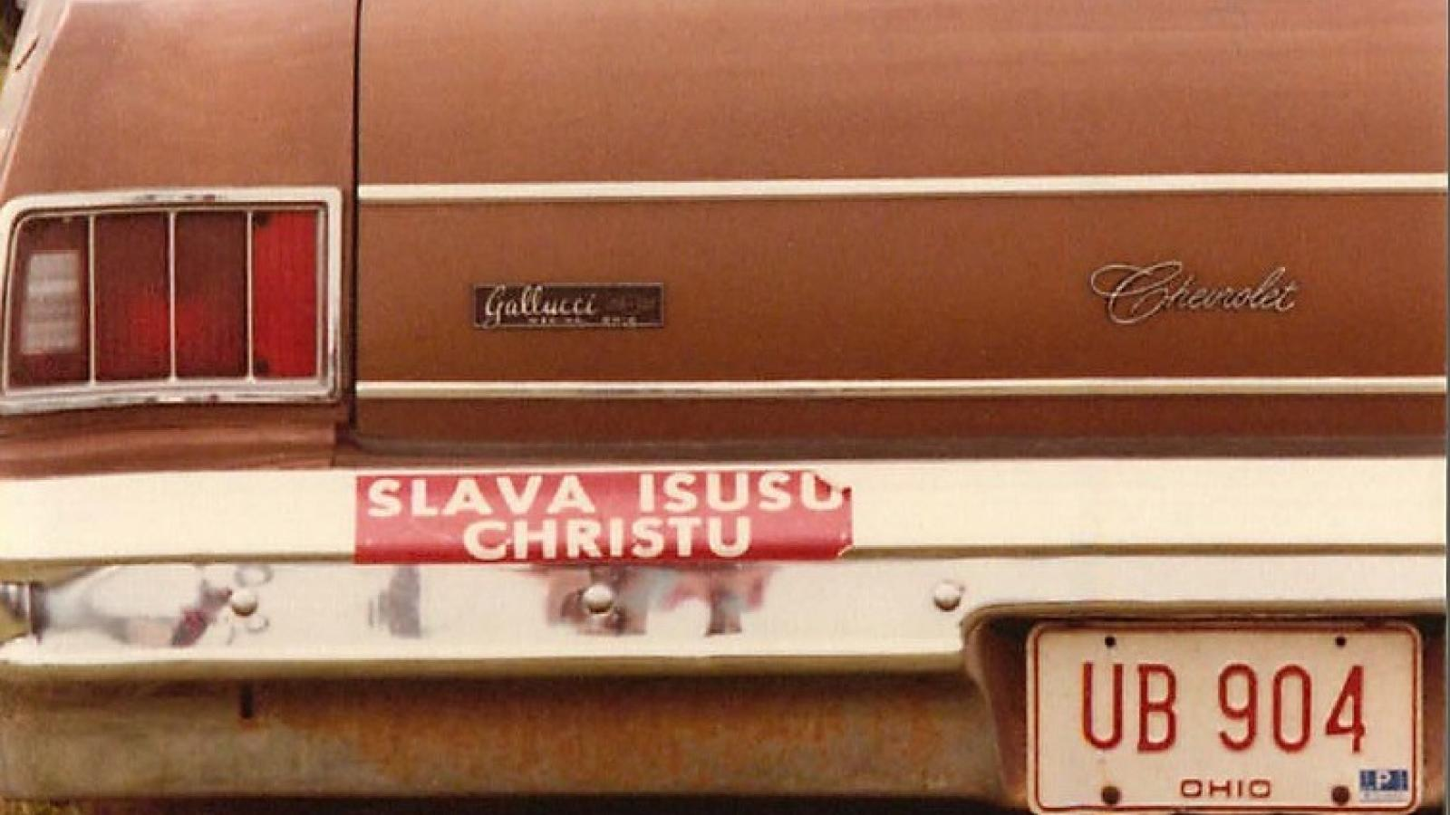 "Bumper sticker reading ""Glory to Jesus Christ"" in Russian words with Latin script."