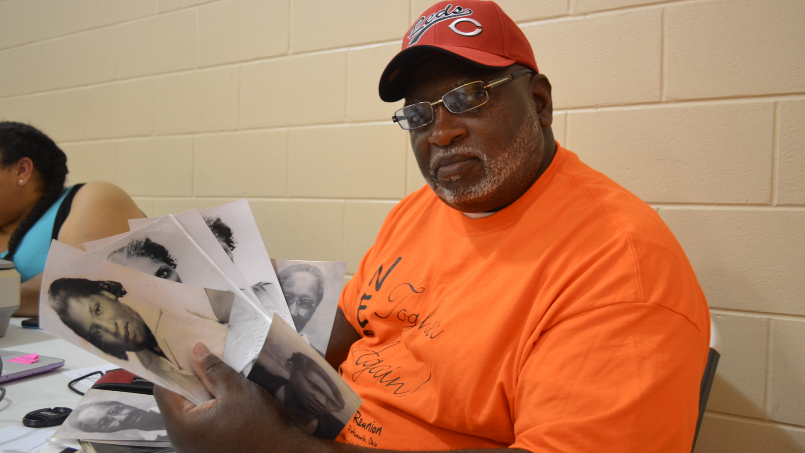Roderick Wilson scans his family photographs at the North End Super Reunion, July 2017.