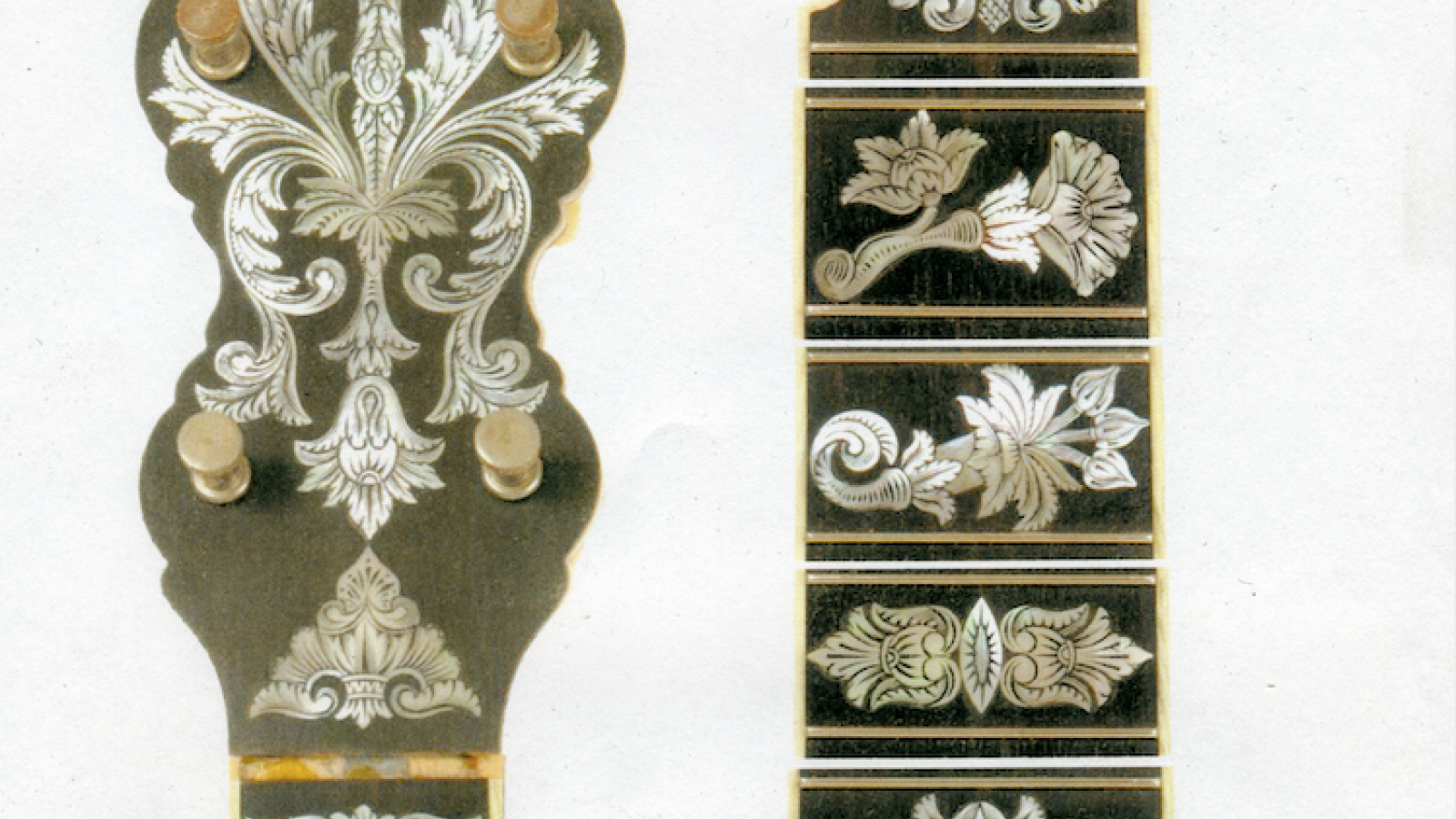 Engravings on the neck of a banjo