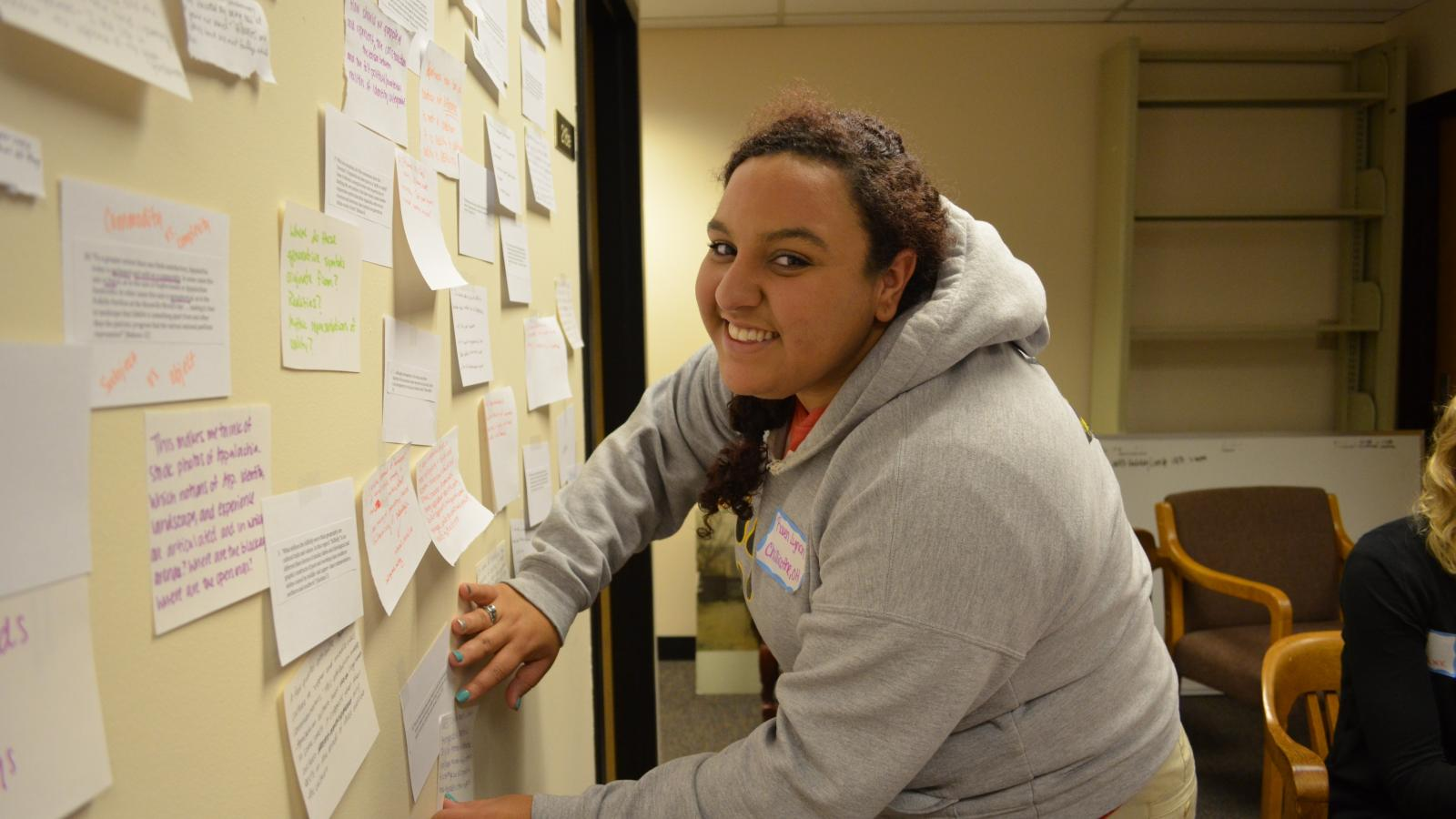 Raven Lynch posts on the brainstorm board at the 2013 retreat