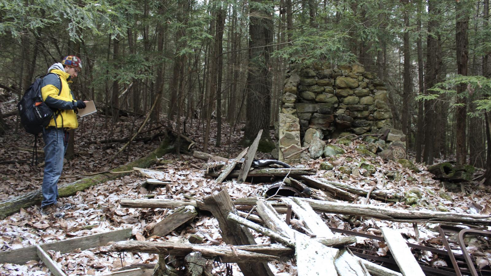 "Frankie Isabelle III stands before the ruins of ""liar's lodge"" at Lake Katharine State Nature Preserve."